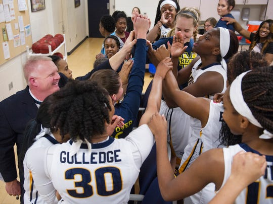 The Murray State Racers celebrate their win over Austin Peay which improved their record to 14-11 (6-6 OVC) Saturday evening.