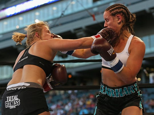 Kristin Gearhart (R) and Amanda Cooper land punches