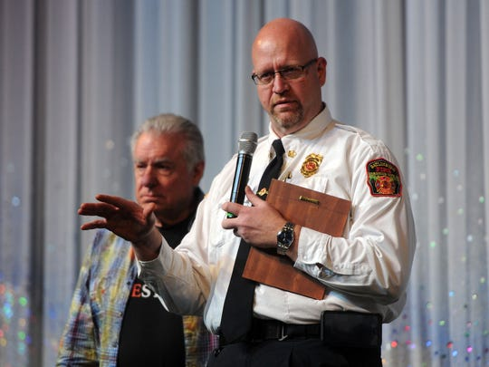 "Gatlinburg Fire Chief Greg Miller speaks to the crowd of Westgate employees in the Smokey Mountain Oprey Theater at the ""Honor our Heroes"" event on Dec. 14, 2016. The event celebrates the many first responders and employees who helped evacuate guests, as well as the speedy re-opening of the resort."