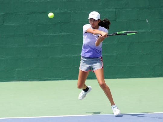 Abilene High;s Ruth Hill follows through on a shot during the fourth-round qualifier of the Girls' 16 USTA Texas Slam consolation bracket at Abilene Christian University on Tuesday. Hill won 2-6, 6-4, 10-8.