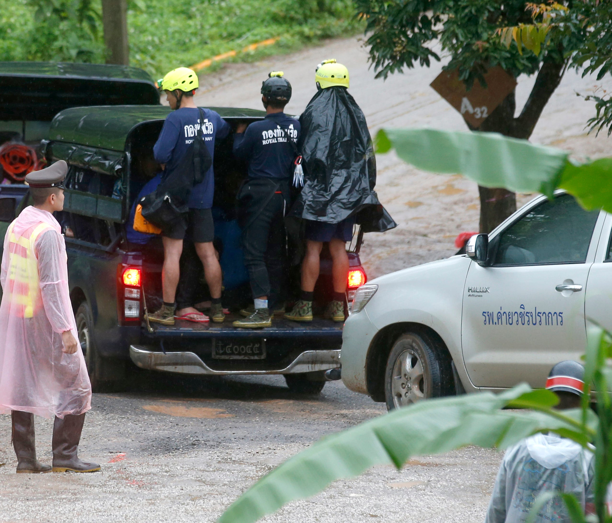 Rescuers move to the entrance to a cave complex where five stil lwere trapped in Mae Sai, Chiang Rai province, northern Thailand.