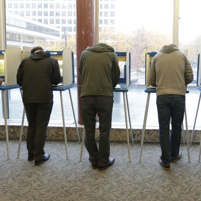 People line the voting booths at the Frank P. Zeidler