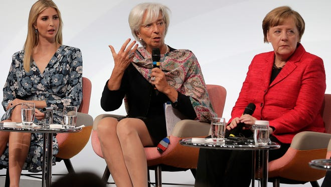 Ivanka Trump, daughter and adviser of President Donald Trump,  International Monetary Fund Managing Director Christine Lagarde and German Chancellor Angela Merkel, from left, talk during a panel of the W20 Summit in Berlin on April 25.