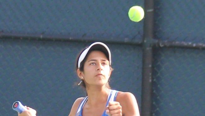 Seven Hills' Alana Saggar keeps her eye on the ball.