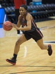 UofL senior guard Taylor Johnson drives to the basket