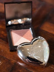 Amanda Hiner's Too Faced highlighter and Laura Mercier