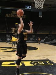 Iowa's Megan Gustafson takes a shot during practice