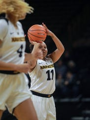 Iowa's Tania Davis shoots a 3-pointer during the Hawkeyes'