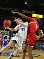 South Dakota State's Myah Selland (44) tries to score