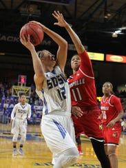 South Dakota State's Macy Miller (12) tries to get