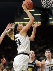 Iowa's Carly Mohns goes up for a shot during the Hawkeyes'