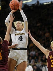 Iowa's Chase Coley fades back for a shot during the