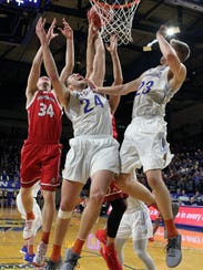 South Dakota State's Mike Daum (24) fights for a rebound