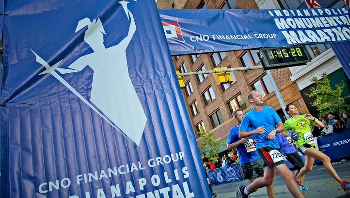 Runners finish their half marathon race during the CNO Financial Indianapolis Monumental Marathon, Saturday, November 5, 2016.