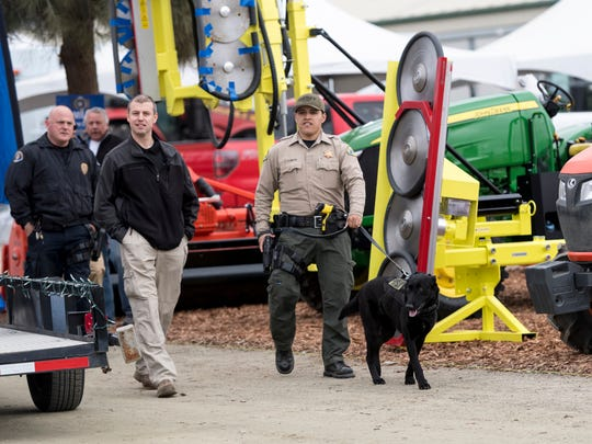 Law enforcement officers patrol during the World Ag Expo at the International Agri-Center in Tulare on Monday, February 12, 2018.