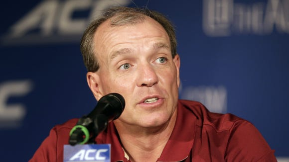 Florida State coach Jimbo Fisher answers a question during a news conference at the Atlantic Coast Conference Football kickoff in Greensboro, N.C.
