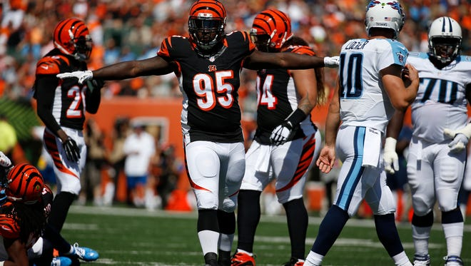 Cincinnati Bengals defensive end Wallace Gilberry (95) reacts to a big stop in the first quarter against the Tennessee Titans at Paul Brown Stadium. The Enquirer/Jeff Swinger