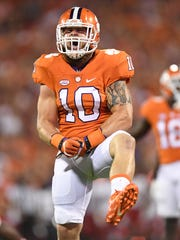 Clemson linebacker Ben Boulware (10) reacts after a defensive stop against Louisville during the 1st quarter on Saturday, October 1, 2016 at Clemson's Memorial Stadium.