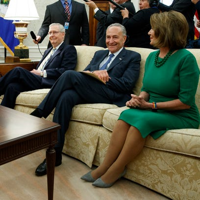 President Donald Trump pauses during a meeting with,