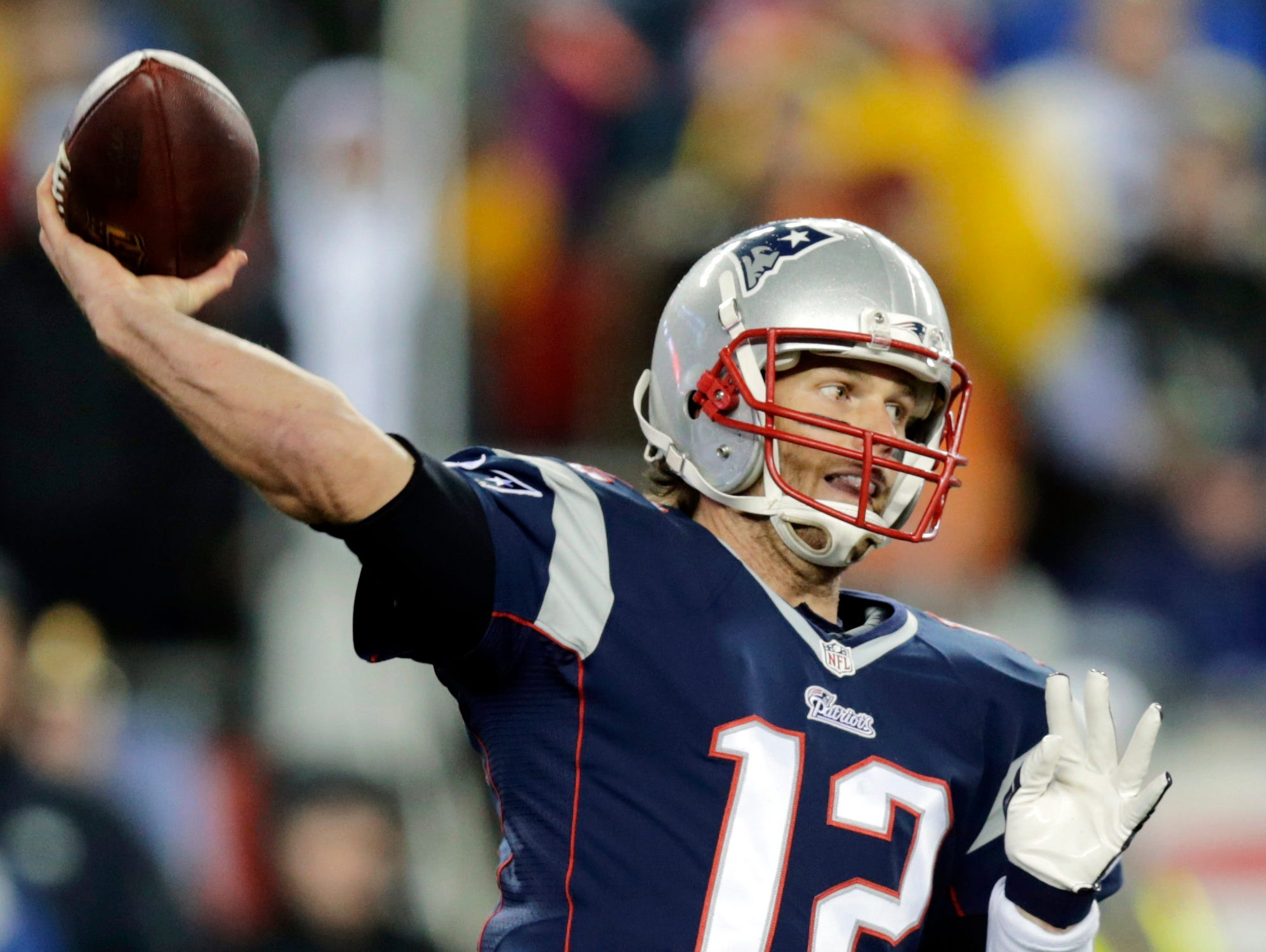 New England Patriots quarterback Tom Brady throws a pass during the first half of the AFC championship game against the Indianapolis Colts in Foxborough, Mass.