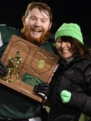 Adam Hicks poses with the Division III, Region 9 championship with his mother, Carrie, last year. Hicks, a 2020 Aurora graduate, recently decided to continue his academic and football careers at John Carroll University in University Heights.