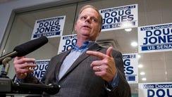 Democratic U.S. Senate candidate Doug Jones talks with