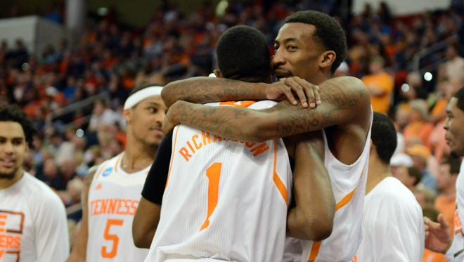 Tennessee Volunteers guard Jordan McRae (52) and guard Josh Richardson (1) celebrate in the closing second against the Mercer Bears in a men's college basketball game during the third round of the 2014 NCAA Tournament at PNC Arena.
