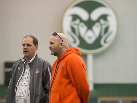 CSU coach Mike Bobo and now-former offensive coordinator Will Friend watch the Rams run drills during pro day at the CSU indoor practice facility Wednesday, March 9, 2016.