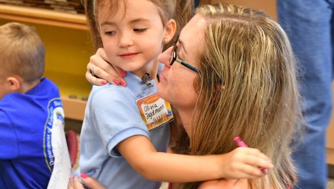 Open enrollment at Brevard's six choice schools is going on now through Dec. 2. Olivia Jagdmann gets a hug from her mom Amy at Freedom 7 Elementary in this 2017 file photo. Freedom 7 is one of the district's four choice elementary schools.