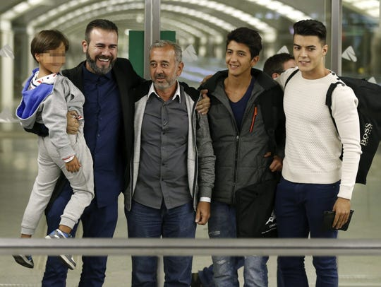 Osama Abdul Mohsen (3rd left) and his son Zaid (left),
