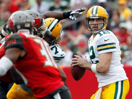 Green Bay Packers quarterback Aaron Rodgers looks to throw against the Tampa Bay Buccaneers on Dec. 21, 2014.