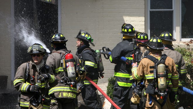 Katonah firefighters battle a house fire on Allison Road in Katonah April 18,  2017. Firefighters from several northern Westchester departments assisted at the scene.