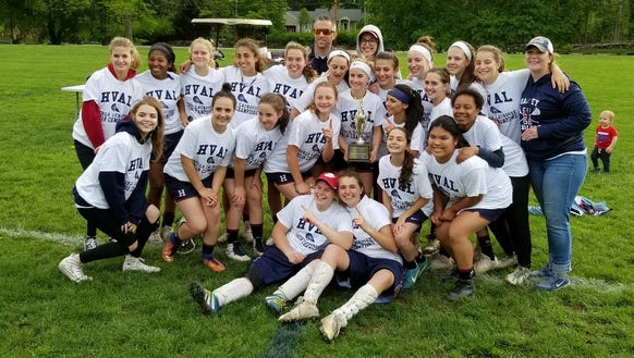 Harvey's girls lacrosse team poses after winning the