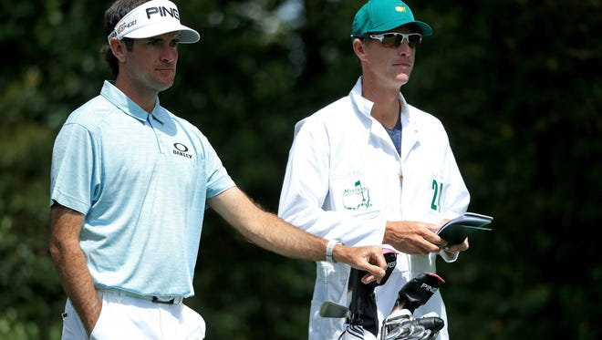 AUGUSTA, GA - APRIL 06:  Bubba Watson of the United States waits with caddie Ted Scott before hitting his shot from the second tee during the second round of the 2018 Masters Tournament at Augusta National Golf Club on April 6, 2018 in Augusta, Georgia.  (Photo by Andrew Redington/Getty Images)