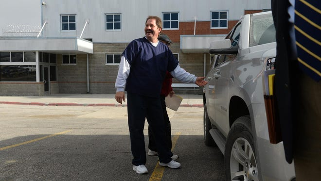 Barry Beach gets into a SUV to leave the Montana State Prison in Deer Lodge a free man Friday afternoon after Gov. Steve Bullock granted clemency for Beach, who has served more than 30 years in prison for a murder he says he did not commit.