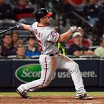 Washington Nationals second baseman Dan Uggla (26) hits a three run home run against the Atlanta Braves during the ninth inning at Turner Field. The Nationals defeated the Braves 13-12.