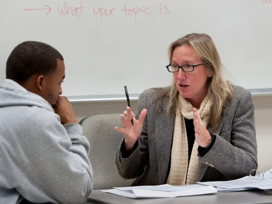 In this 2013 file photo, Christina Lynch, right, talks with Michael Hopson in her English 1 class at College of the Sequoias.