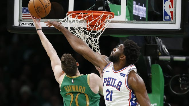 Celtics guard Gordon Hayward (20) is challenged by 76ers center Joel Embiid during a game in December at TD Garden.