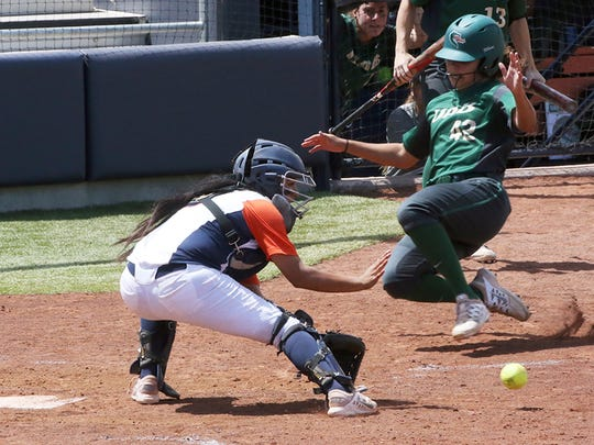 UAB's Lizzie Ryan slides into home plate as UTEP catcher Linda Garcia catches the throw Saturday at Helen of Troy Field. The play was close but Ryan was ruled safe.
