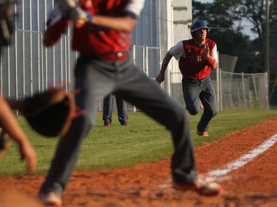 Wakulla Christian's Aiden Driscoll-Sadusky races home on a suicide squeeze, scoring on a successful bunt.