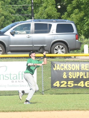 Lockeroom right fielder Ben Henderson catches a fly ball during a recent game at Cooper Park.