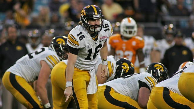 Iowa Hawkeyes quarterback C.J. Beathard (16) calls an audible in the third quarter of the 2015 TaxSlayer Bowl against the Tennessee Volunteers at EverBank Field. The Tennessee Volunteers beat the Iowa Hawkeyes 45-28.