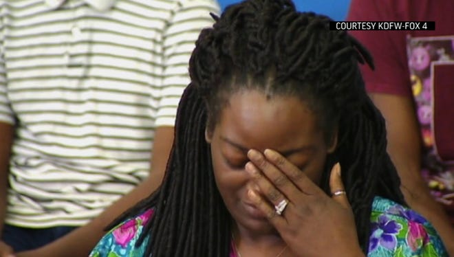 In this image made from video provided by KDFW-FOX4, Shetamia Taylor reacts during a news conference at Baylor University Medical Center in Dallas on Sunday, July 10, 2016.