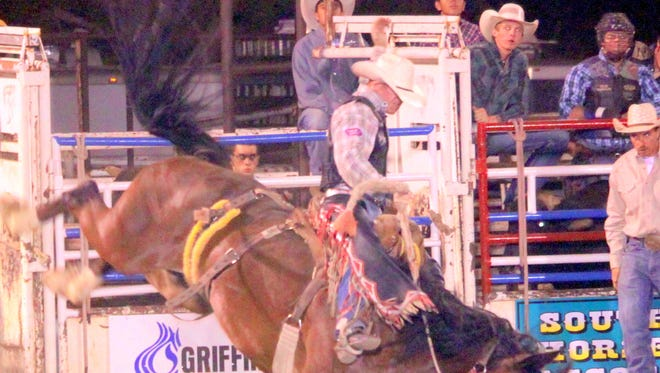 Jacobs Crowley scored an 84 on Hang em High during rodeo action Friday to claim the top spot in the saddle bronc riding competition.