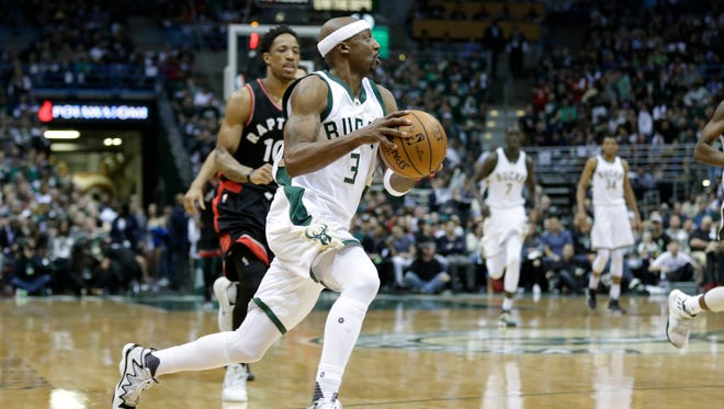 Bucks guard Jason Terry dribbles up the court in front of Raptors guard DeMar DeRozan after stealing the ball in the first half of Game 4 on Saturday at the BMO Harris Bradley Center.