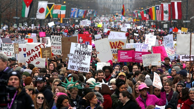 Thousands of protesters participate in a women's march on the Benjamin Franklin Parkway in Philadelphia in January 2017.