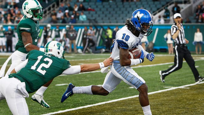 Memphis' Dontrell Nelson (10) returns an interception past Tulane quarterback Tanner Lee (left) on his way to a 58-yard touchdown in 2014.