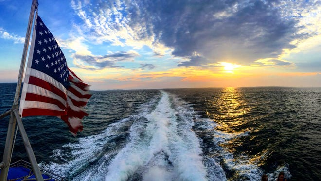 The sunset over the Atlantic Ocean aboard the Seastreak Ferry.