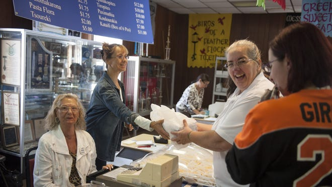 Volunteers serve authentic Greek pastries during the annual Greek Agora Festival at St. Thomas Greek Orthodox Church in Cherry Hill last year.
