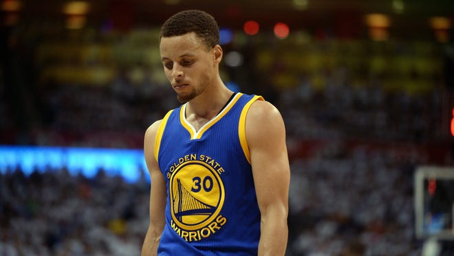 Stephen Curry reacts after a play against the Oklahoma City Thunder during the third quarter in game four of the Western conference finals